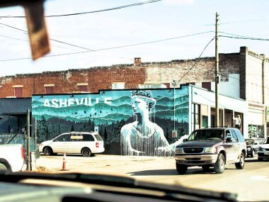 Asheville mural seen through front window in car