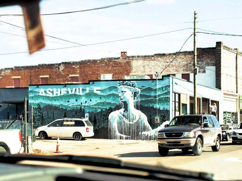 Asheville mural seen through front window in car