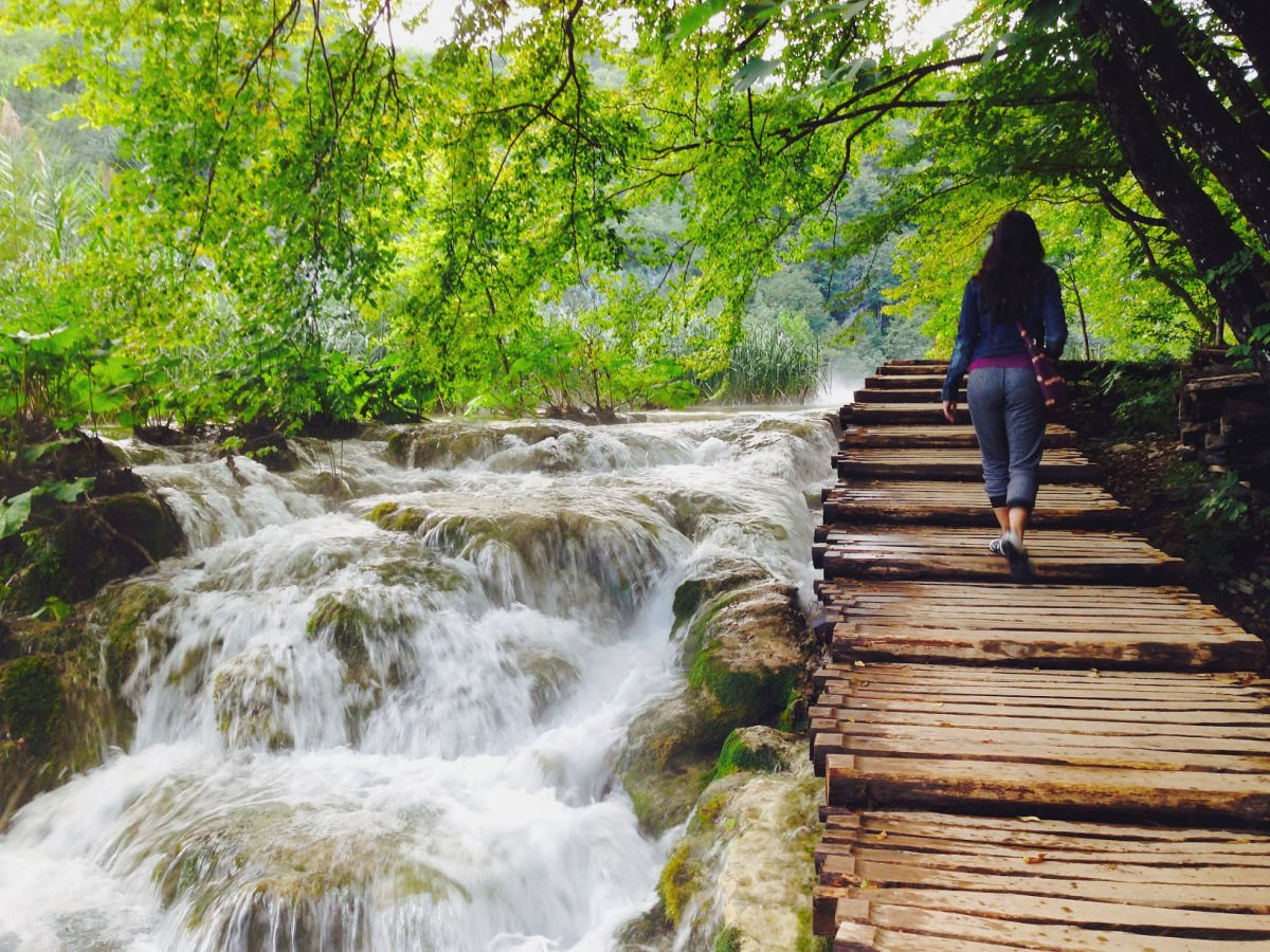 Walking through Plitvice Lakes waterfall