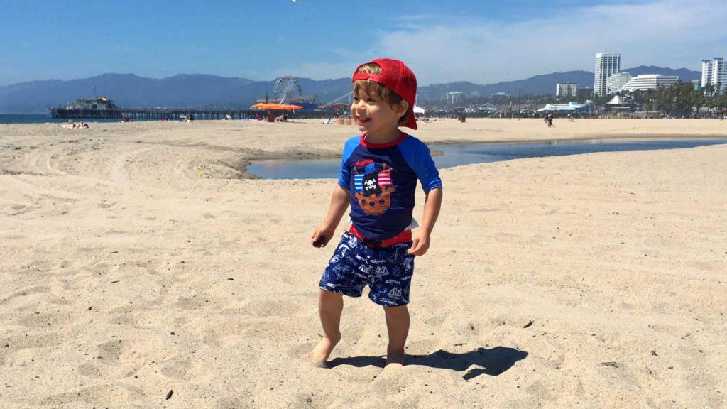 Toddler Playing on Beach