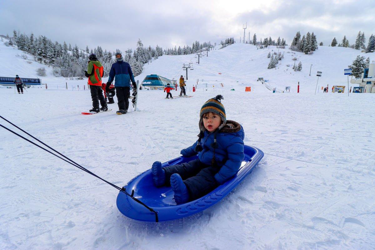 Toddler sledding at Bogus Basin ski resort in Boise Idaho