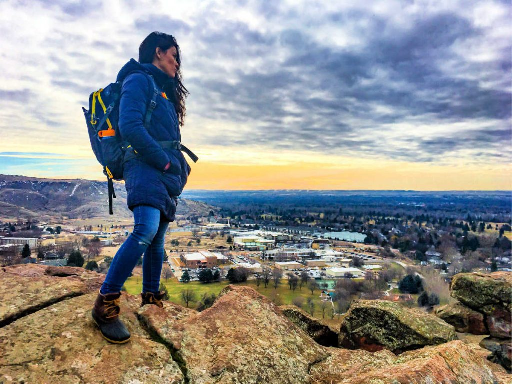 woman standing on mountain in Boise