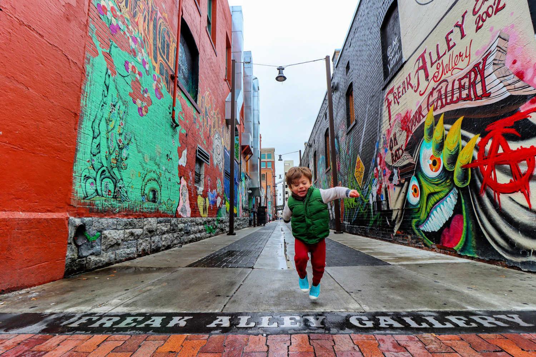 Toddler Skipping Through Mural Gallery in Boise Idaho