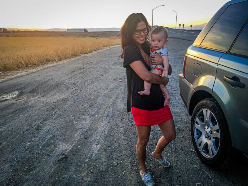 young mom on road trip with baby