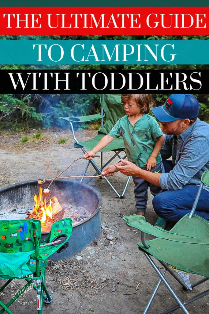 Camping with toddlers graphic for Pinterest. Three year old boy roasting marshmallows with dad at campsite.