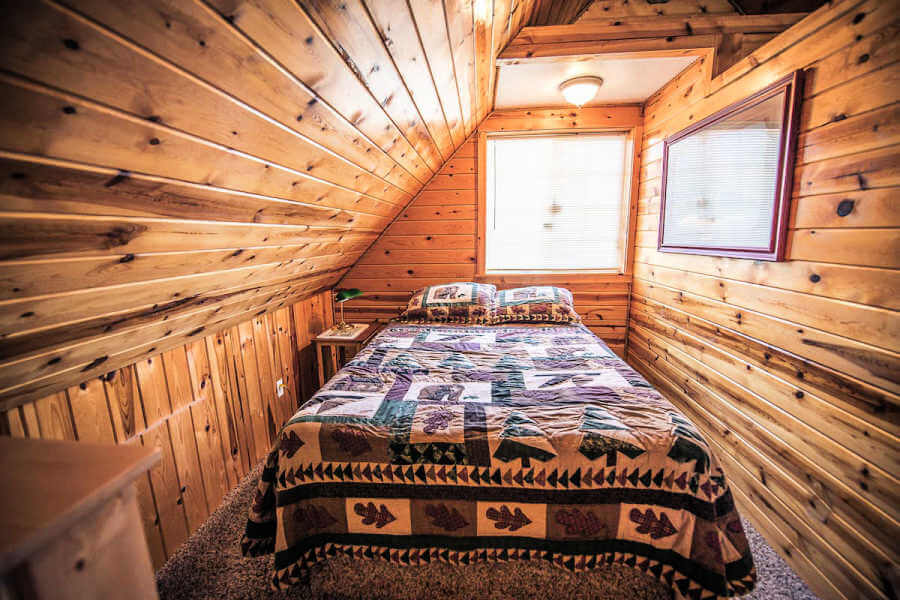 all wood bedroom with rustic bed