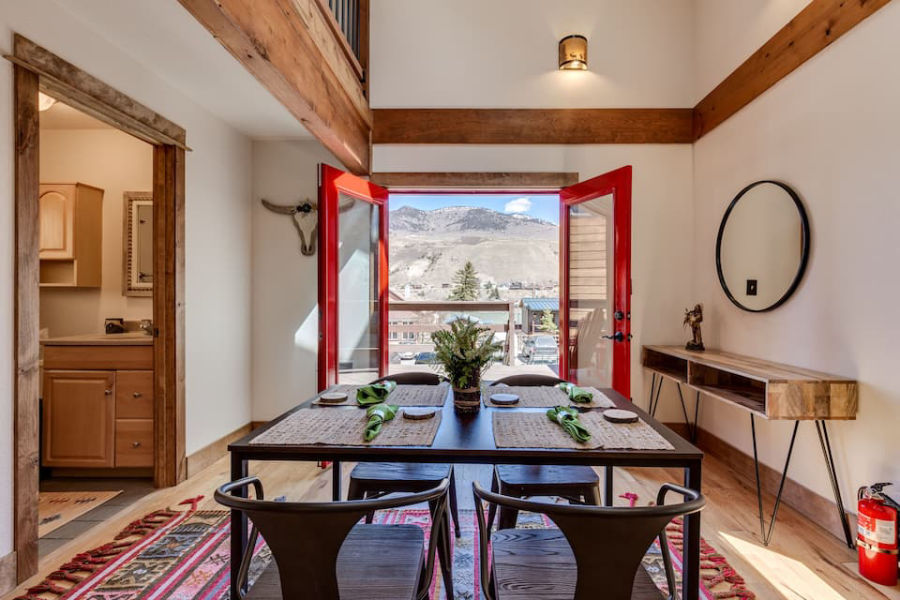 yellowstone airbnb with dining room looking out at mountains
