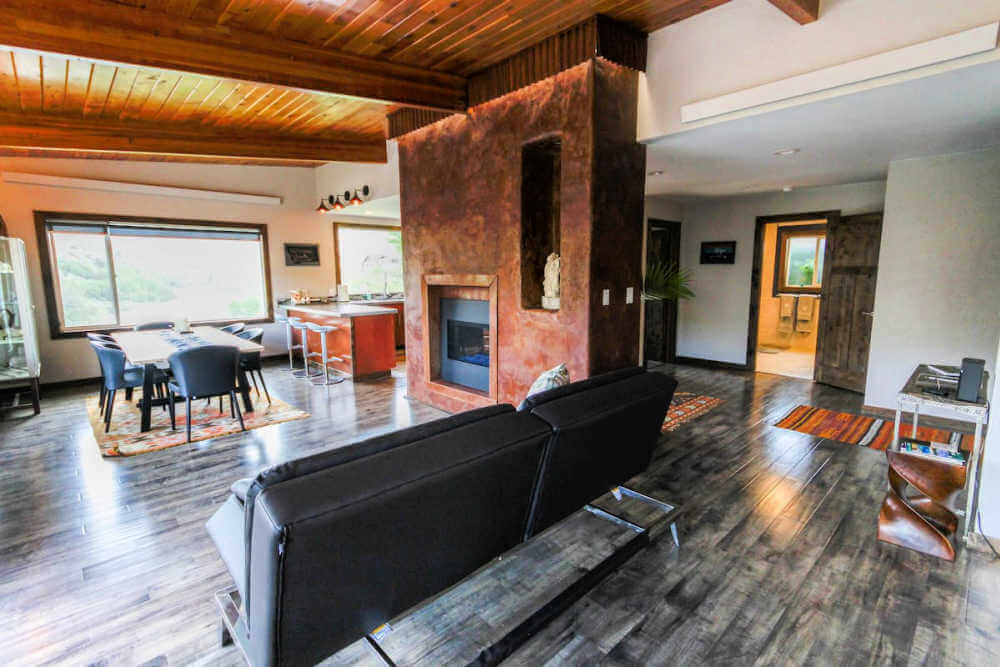 posh Yellowstone airbnb rental with open concept living room and fireplace