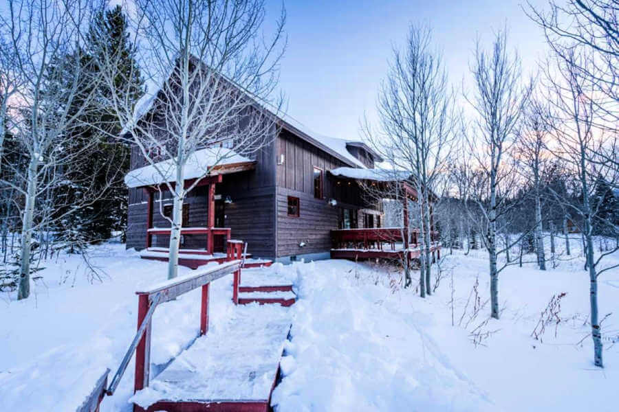 cabin in winter in yellowstone