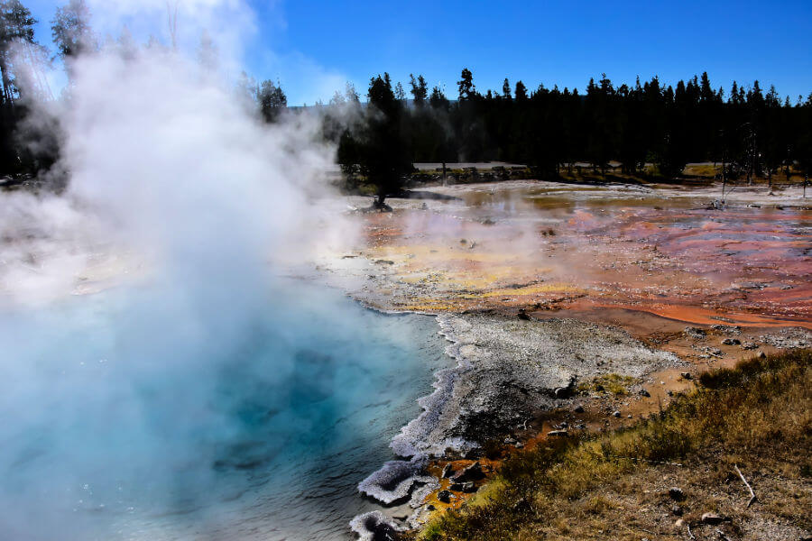 colorful hot spring letting off steam in yelloedyonr