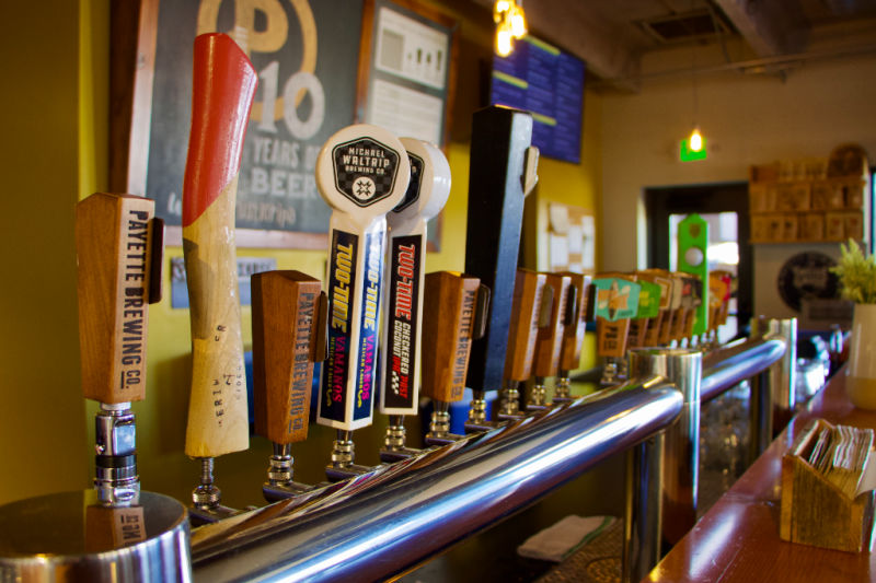 line of taps in a hip brewery in boise