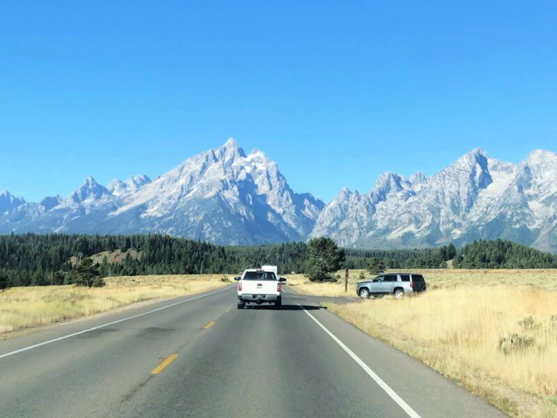 driving a cross country road trip though Grand Teton National Park