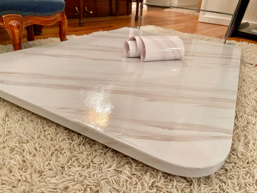 white marble contact paper on dining table RV set