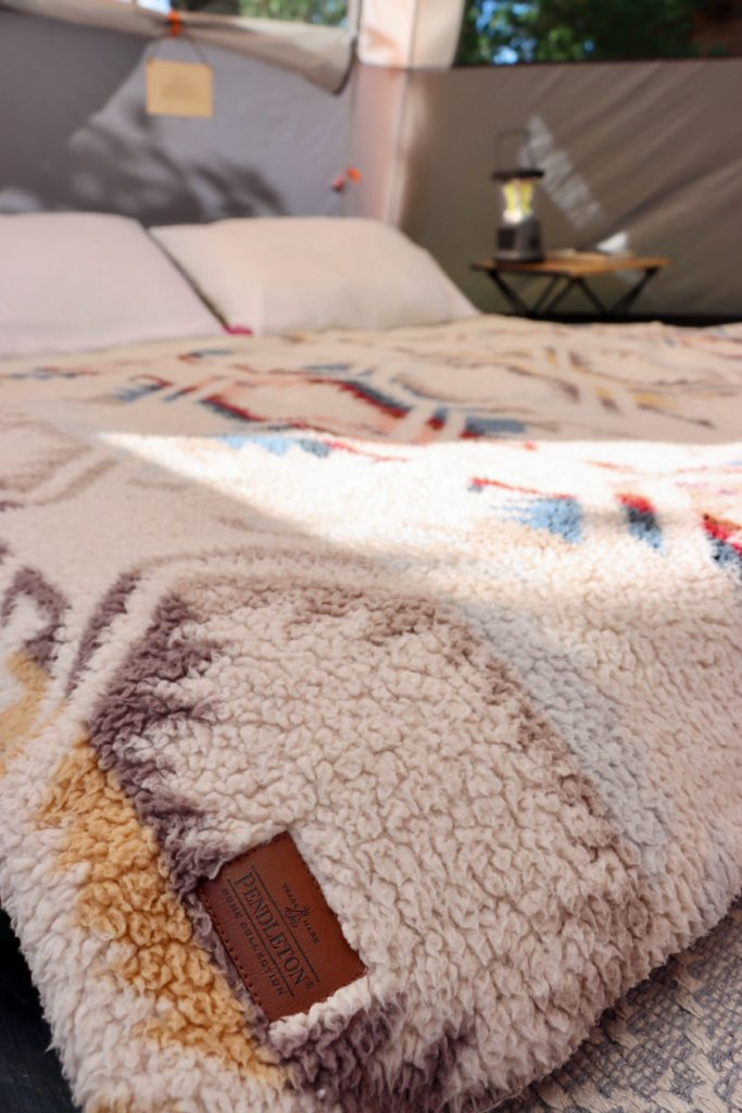 fleece Native American inspired print on  bed in glamping tent
