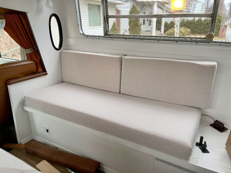 off white love seat being built in rv renovation