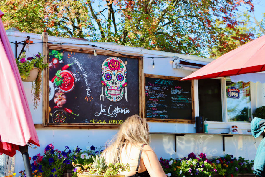 Mexican food truck with day of the dead skeleton as logo