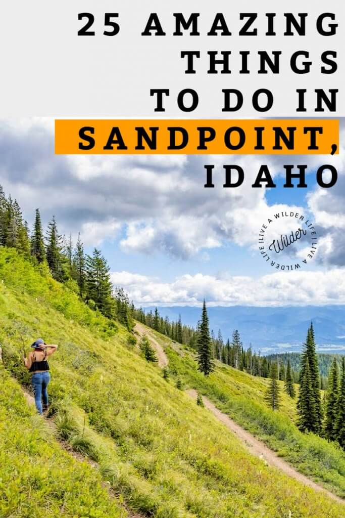 """Pinterest graphic with title """"25 Amazing Things To Do In Sandpoint."""" Woman hikes up an open mountainside with views of large lake."""