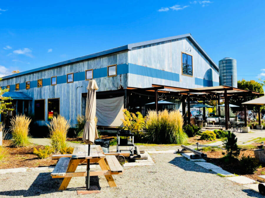 rustic hip metal brewery with outdoor seating